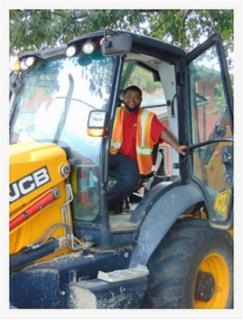 Public Works employee in tractor